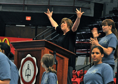"GWU's Joyful Hands teach the DAWG Days crowd the sign for ""What's up?"""