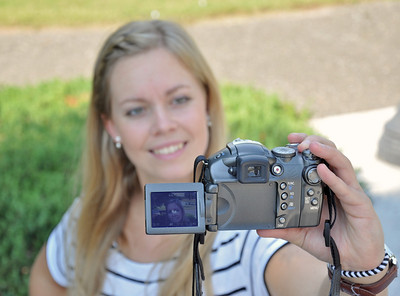 Exchange student Karin Mattgard practices photography for her communications class.