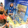 Tour: Emily Grannis (blue) gives a brief tour of the American Coalition For Clean Coal Electricity traveling display at the square in Rockville Friday afternoon.