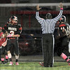 Score: South's ##, Tyler Seibert looks to the official after scoring a touchdown during first half action Friday night.