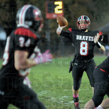 Open: Terre Haute South's #8, Danny Etling looks to receiver #34, Logan Buske during first half action Friday night.