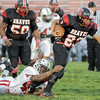 Gotcha: South's #23, Tre Stephens is tackled by a Lawrence North defender during game action Friday night.
