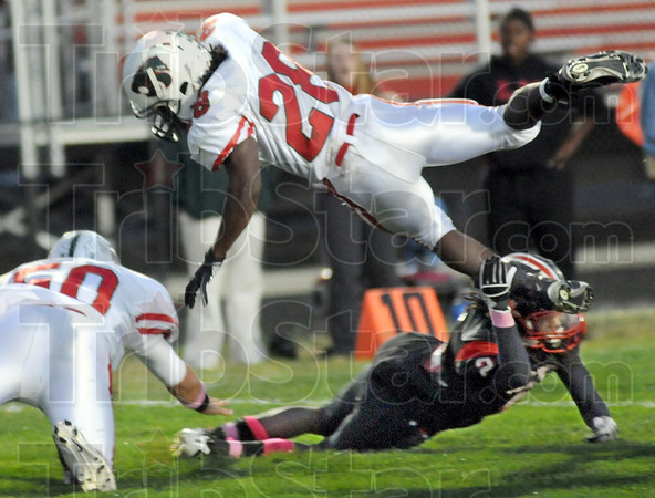 Shoestring stop: South's #2, John Story gets just enough of a leaping Jarren Scott to stop him just one yard short of the goal line Friday night.