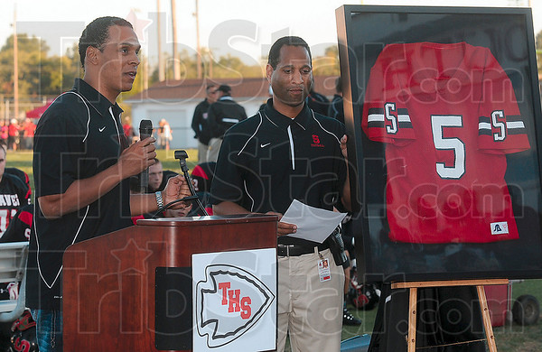 Tribune-Star/Joseph C. Garza<br /> Thank you, Terre Haute South: Former NFL player Tony McGee thanks all of the members from the community that supported him throughout his youth during a ceremony to retire his jersey Friday at South. Standing next to McGee is South Athletic Director Tony Brewer.