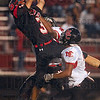 Tribune-Star/Joseph C. Garza<br /> A catch above the rest: Terre Haute South wide receiver Tyler Seibert makes a leaping catch as he is covered by two North Central defenders in the first half of action Friday at South.