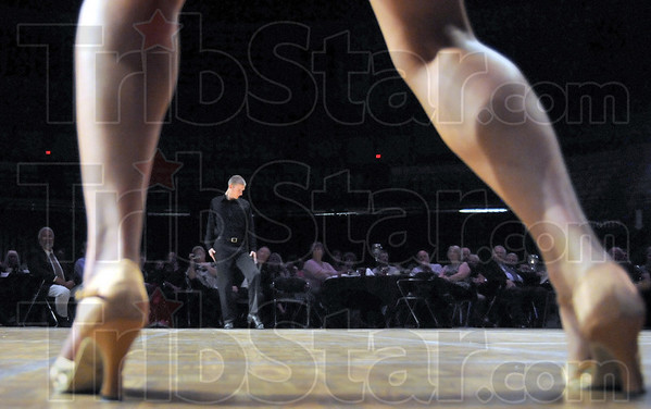 Dance: Professional dancer Mark Montgomery waits for the music to start as he performs with Christa Pierce (legs) during the annual Dancing with the Stars.