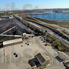 Up on the roof: Spread out on the grounds of Duke Energy's Cayuga Generating station is the coal yard and the railroad tracks and cars that bring the coal in. Beyond that is the series of filtration ponds that cleans part of the water used at the plant. In the distance is Inland Container, a cardboard recycling operation that was built near the Duke station to use the by-product of steam.