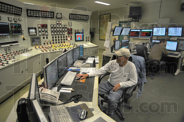 Control room: Jim Silk and Dale Keitel work in the control rom of Duke Energy's Cayuga Generating Station Friday afternoon. The facility celebrated its 40 year anniversay.
