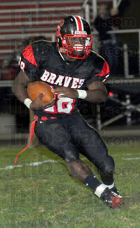 Workhorse: Terre Haute South running backTyler Evans heads to the endzone for the second Brave touchdown.