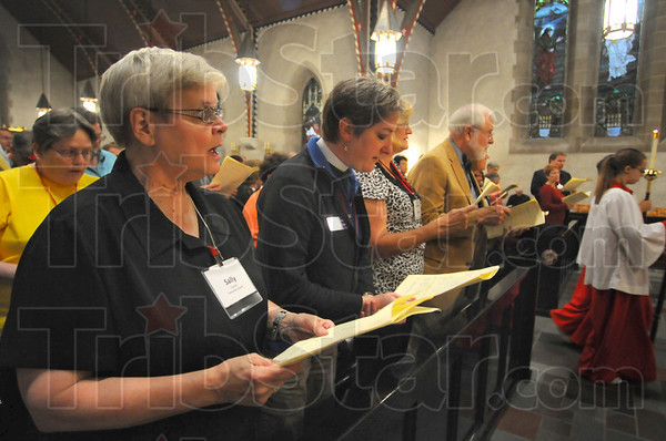 Evensong: Sally Cassidy and Reverend Canon Debra Kissinger sing with  rest of the Episcopalian Convention at the Evensong event Thursday night at St. StephenÕs Church.