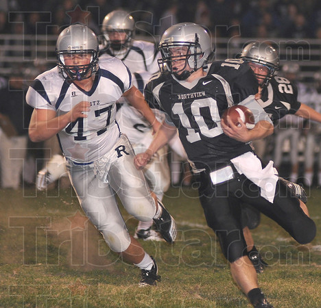 Up field: Northview quarterback Trent Lancaster(10) finds running room agaisnt Evansville Reitz. Defending on the play is Panther linebacker Brandon Kemp (47).