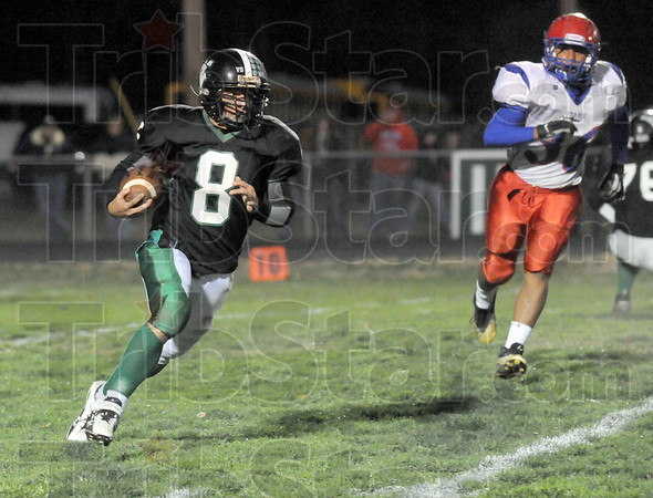 Running room: West Vigp's #8, Dylan Aff looks for some running room as he returns the ball against Westrn Boone Friday night at the westside school.