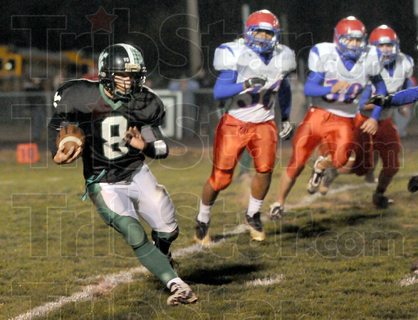 Evade: West Vigo's #8, Dylan Aff evades tacklers during first half action against Western Boone.