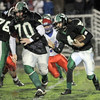 Leading the way: West Vigo's #70, Luke Kernstein leads the way for ball carrier #4, Chase Silcock during sectional action Friday night.