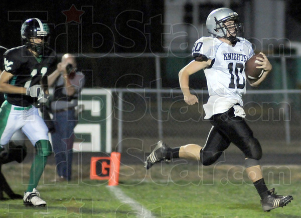 Touchdown: Northview quarterback Trent Lancaster crosses the goal line to score a touchdown against West Vigo Friday evening.