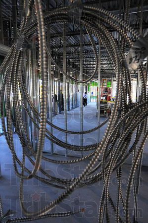 Under construction: Coils of conduit hang on the second floor of the new Barnes and Noble building at 5th and Cherry Streets. Tours were given Friday of the structure that will also house offices for the Indiana State University Foundation.