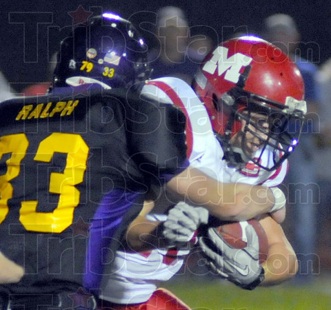 Stopped: Warrior Jacob Ralph stops Marshall runningback Patrick Parsley in first quarter action in Casey Friday night.