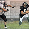 Pressure: Two Northview defenders chase West Vigo quarterback #6, Lance Garrett during second quarter action Friday night.