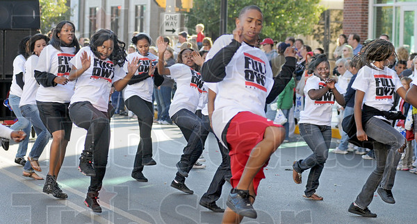 Full Owt: Dancers perform for the huge crowd as they participate in the annual Blue and White Parade.