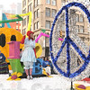 Happy face, peace and love: A large float passes 7th and Wabash Saturday morning during the annual Blue and White Parade.