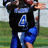 You take it: Pitchouts were used often by Sycamore quarterback Ronnie Fouch.