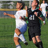 Contested: Terre Haute North's Derek Hakman and Viking Dustin Gilbert(21) vie for control of the ball in first half action of their championship match.