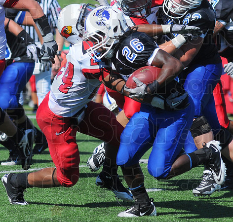 End run: Sycamore Shakir Bell stiff-arms his way past Redbird defender Kelvyn Hemphill.
