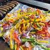 Food detail: Detail photo of some of the foods available at the tent city at Memorial Stadium.