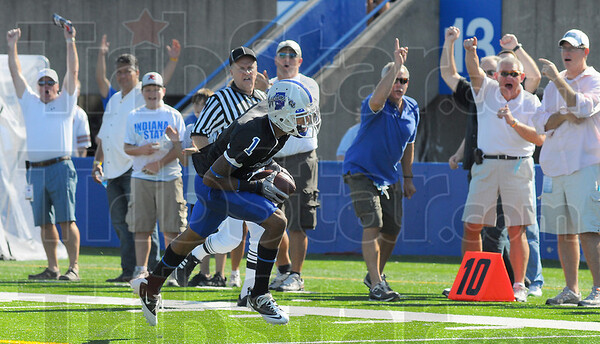 You go: ISU alums and other cheer on Bryant Kent as he heads to the endzone for the first Sycamore touchdown.