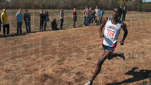 Tribune-Star/Joseph C. Garza<br /> Cruising for a repeat: Liberty University's Samuel Chelanga runs through a curve in the Lavern Gibson Championship Course as he leads the pack during the 2010 Pre-NationalsÕ MenÕs White race Saturday. Chelanga won the men's white race with a time of 23:19.9 minutes.