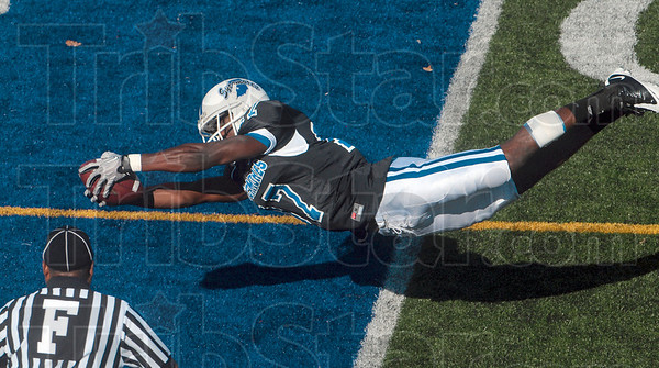 Tribune-Star/Joseph C. Garza<br /> Diving into the deep blue: Indiana State wide receiver Ednut Egberongbe dives into the endzone to score during the Sycamores' win over Missouri State Saturday at Memorial Stadium.