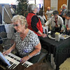 Drawing a crowd: With Ruby Blauvelt on the organ, The Conservatory of Music booth was one of the more crowded at the Senior Expo 2010 Saturday morning in Hulman Center.  With Her in the booth are Dixie Blackwell and Deb Lampton.