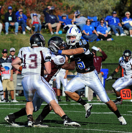 Pressure: Indiana State's Ryan Roberts(15) reaches for Missouri State quarterback Cody Kirby(13).