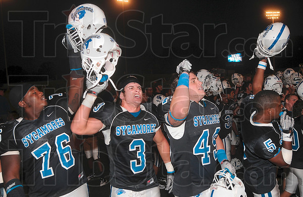 Tribune-Star/Joseph C. Garza<br /> Three and Oh!: Indiana State football players Rod Hardy (76), Alex Sewell (3), Alex Bettag (49) and Calvin Burnett (5) celebrate with their teammates after the Sycamores defeated Missouri State Saturday at Memorial Stadium.