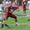 Wide-eyed: Rose-Hulman's #35, Reed Eason makes a quick decision as to the direction of his run during first half action against Bluffton Saturday afternoon. Eason was able to evade the tacklers and make yardage on the play.
