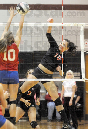 Score: South's #10, Madison Steward pounds the ball past a Plainfield defender Saturday night during sectional play.