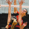 Power stroke: Brave outside hitter Madison Steward spikes past the defense of Terre haute North's Krislyn Moss.