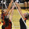 Control: Braves Brittney Pink andSloan Stephens battle at the net with Terre Haute North's Mikinzi Kiefer. The action was in teh afternoon game of the volleyball sectional at Northview.