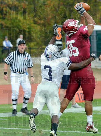Touchdown: Rose-Hulman's #35, Reed Eason makes a catch in the end zone to score against Bluffton Saturday afternoon. Defending for Bluffton is #3, Oscar Vazquez-Dyer.