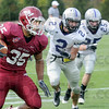 Eason Run: Rose-Hulman's #35, Reed Eason makes yardage after escaping the trailing Bluffton College defenders.