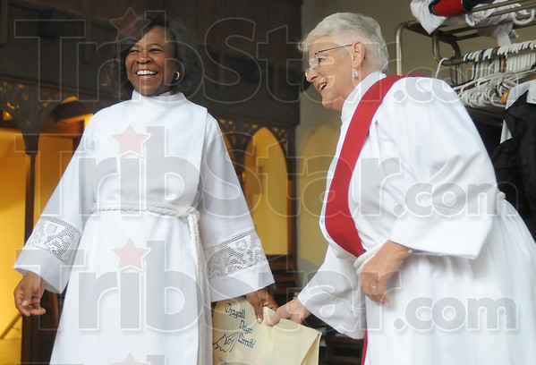 LIghter side: Fatima Madus and Reverend Enid Morrison share a light moment just before Madus' ordination Saturday morning.