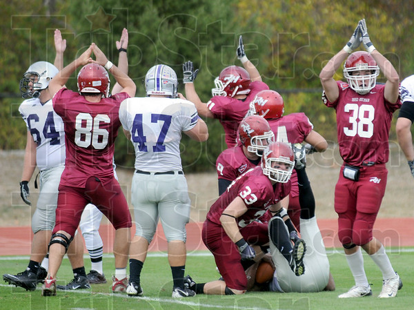 Safety celebration: Rose-Hulman players signal a safety during game action Saturday afternoon. The defense tackled Bluffton's quarterback in the end zone to score two points.