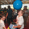 Tribune-Star/Joseph C. Garza<br /> Blown away by science: Ethan Burgess, right, keeps a blue ball floating above his head as he and DeVaney Elementary classmate Cole Brown play with an air blower at the Terre Haute Children's Museum Friday, Sept. 24.