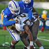 Nowhere to run: Quincy runningback Sterling Ross(20). is brought down by Sycamore defender Jacolby Washington(34).