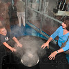 Tribune-Star/Joseph C. Garza<br /> Their heads in the clouds of science: Four-year-old Rylee Williams operates the cloud machine with some help from Karen Propst Friday, Sept. 24 at the Terre Haute Children's Museum.