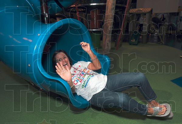 Tribune-Star/Joseph C. Garza<br /> Where even the teachers can have fun: Kathy Spelman enjoys her trip down the slide at the Terre Haute Children's Museum Friday Sept. 24.