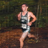 Tribune-Star/Joseph C. Garza<br /> Took the lead and never gave it up: West Vigo's Andrew Kump leads all of his fellow competitors as he  races through a wooded area of the West Vigo cross country course Saturday during the WIC meet.