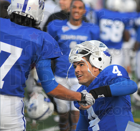 Good times: ISU quarterback Ronnie Fouch allows himself a smile after a touchdown throw against Quincy Saturday.
