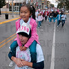 Tribune-Star/Joseph C. Garza<br /> The view from the top: Steffanie Mock, 6, rides on Randy Mock's shoulders as they participate in the Race for the Cure Saturday on Wabash Avenue.