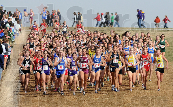Run with the pack: They girls head toward the first turn as they near the end of the straighaway. Eventual winner Waverly Neer of Culver Academies(109) is out front.